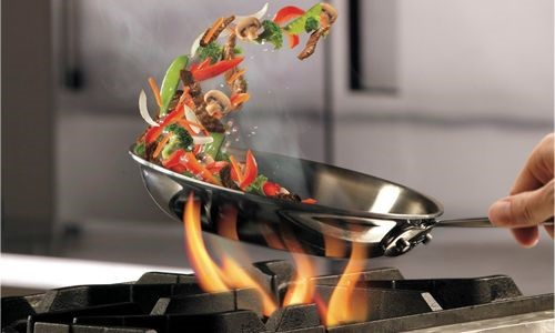 Tossing A Stir Fry Over A Gas Burner