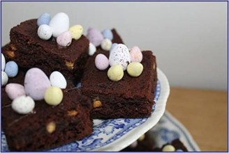 Chocolate brownies decorated with mini eggs