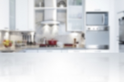 Empty kitchen countertop with defocused modern kitchen background