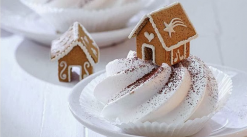 Gingerbread house on top of cream