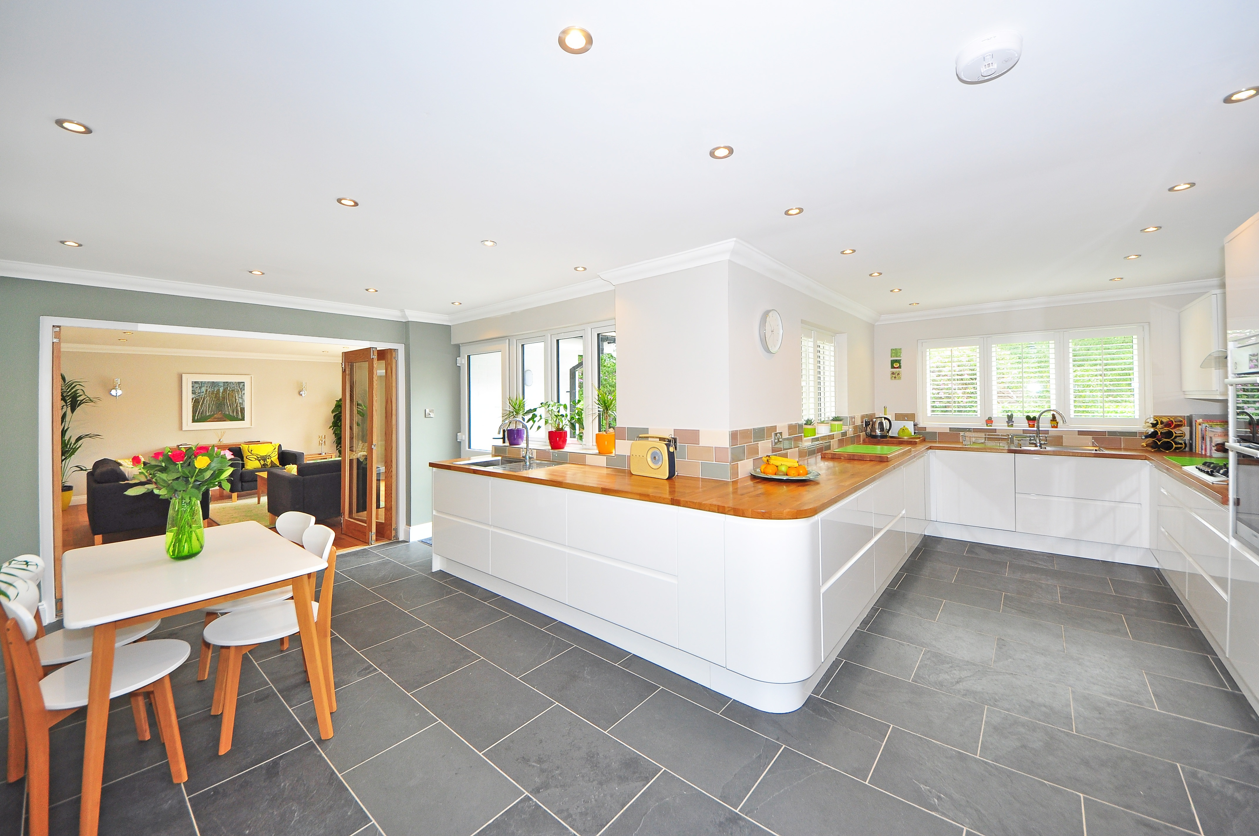 clean kitchen with grey tile floor and kitchen table