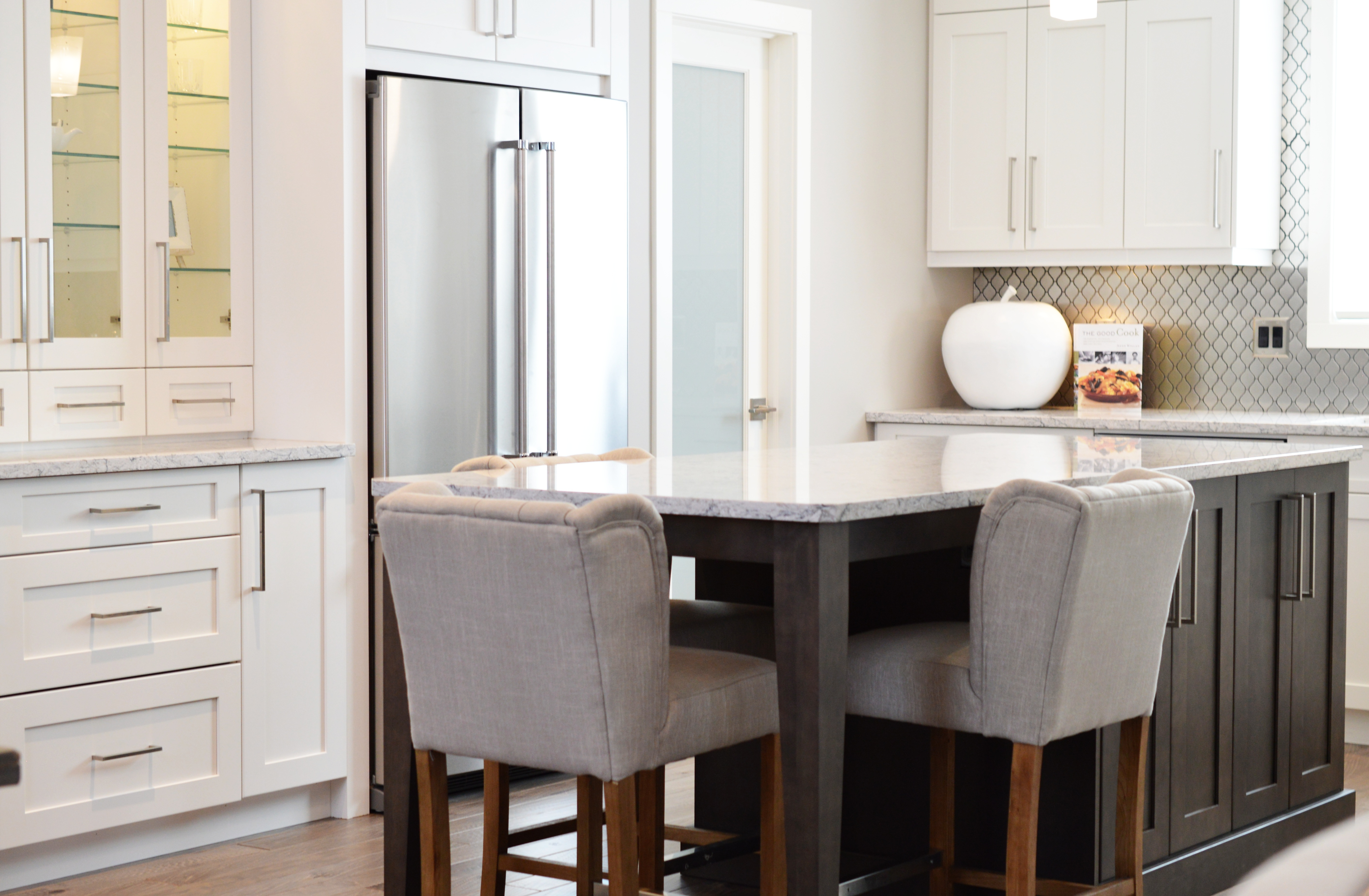 A clean modern kitchen with bar stools