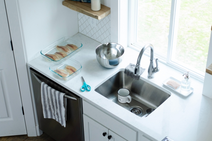 kitchen sink with mug and tea towel