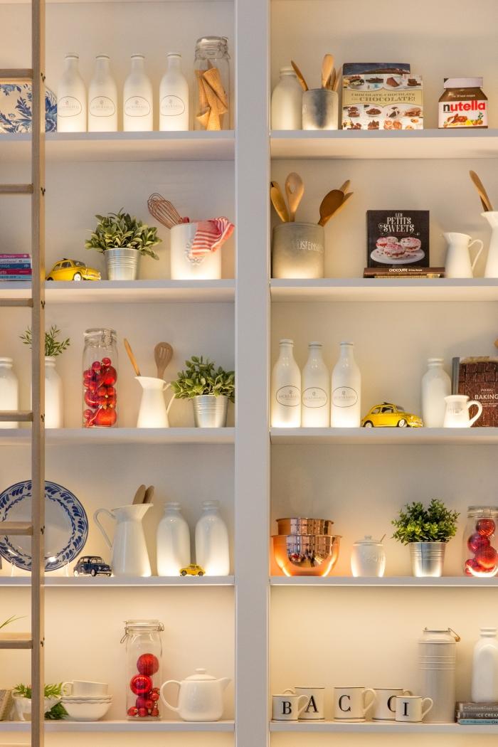 kitchen cupboard organised with utensils