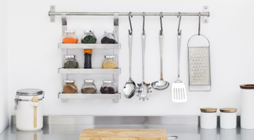 Kitchen utensils and spices in bowls in stainless steel kitchenKitchen utensils and spices in bowls in stainless steel kitchen