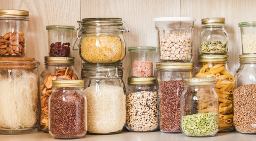 Shelf in the kitchen with various cereals and seeds